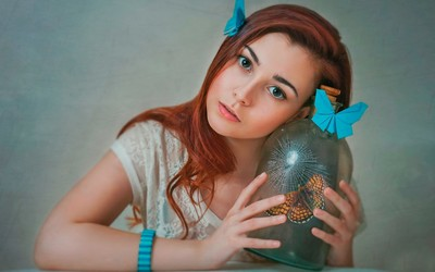 Redhead with a butterfly in a bottle wallpaper