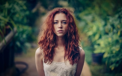 Redhead with blue eyes in a white top Wallpaper