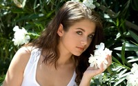 Romantic girl smelling a white flower wallpaper 1920x1200 jpg
