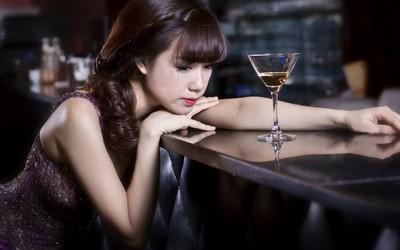 Sad asian girl Wallpaper
