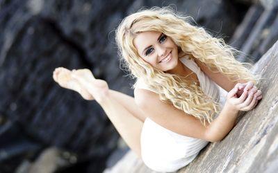 Smiling blonde beauty wallpaper