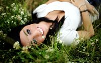 Smiling brunette in the grass wallpaper 2560x1600 jpg