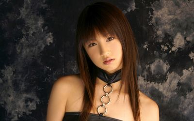 Superb girl in a leather blouse wallpaper