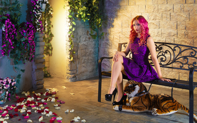 Redhead in a purple dress on a bench wallpaper
