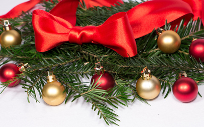 Baubles and ribbon on fir branches wallpaper
