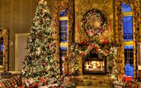 Beautiful Christmas tree by the fireplace wallpaper 1920x1200 jpg