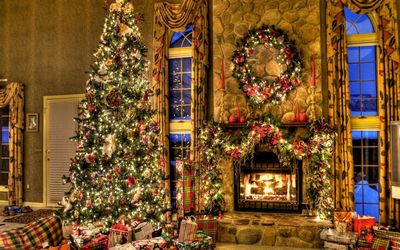 Beautiful Christmas tree by the fireplace wallpaper