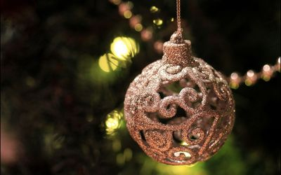 Beautiful silver bauble in the Christmas tree wallpaper