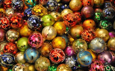Christmas lights reflecting in the colorful baubles wallpaper