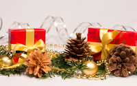Christmas ornaments and presents on a fir branch wallpaper 3840x2160 jpg
