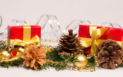 Christmas ornaments and presents on a fir branch wallpaper