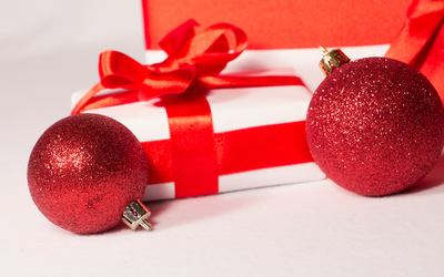 Christmas presents with two red baubles wallpaper