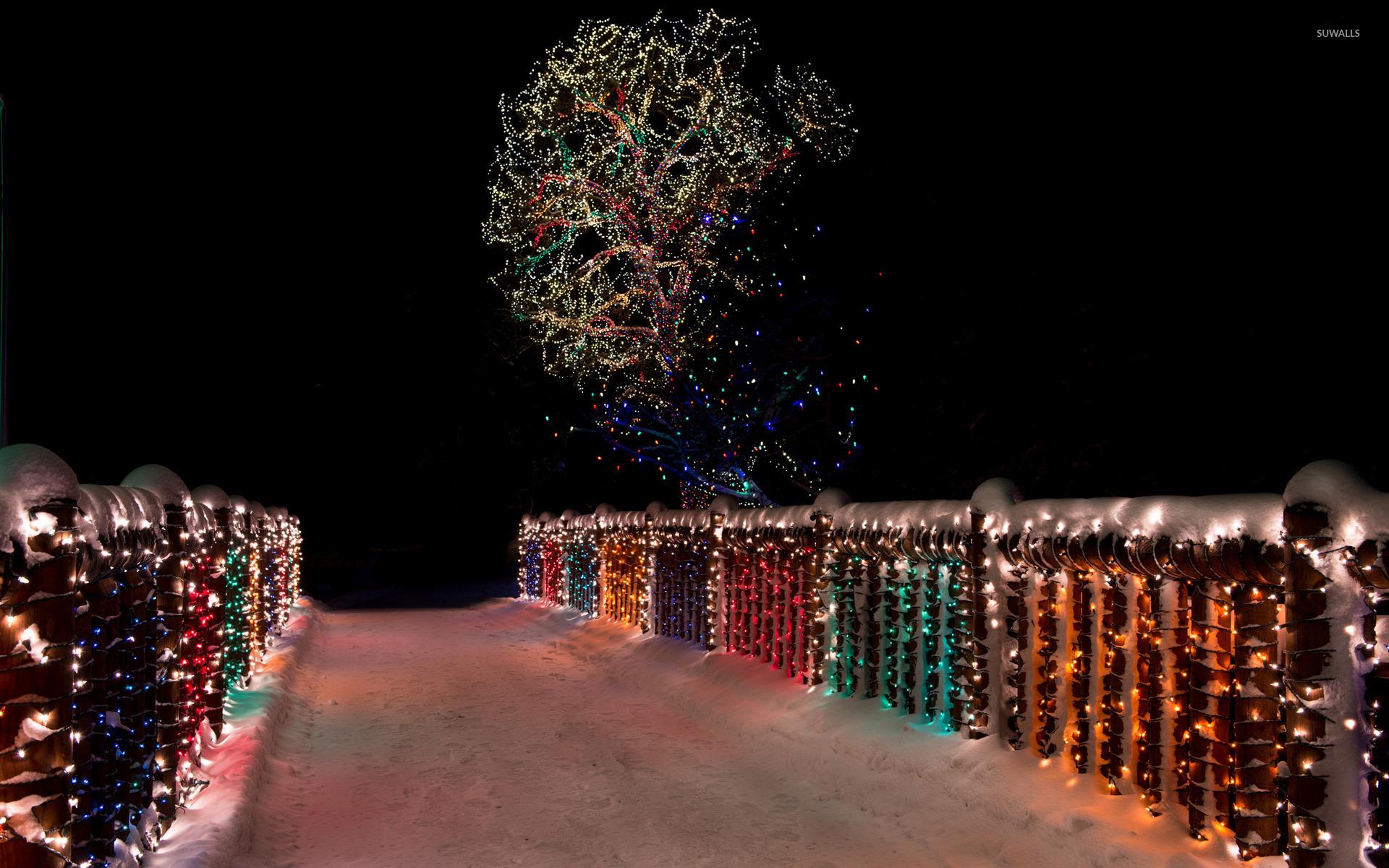 colorful christmas lights on the snowy bridge 45908