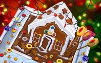 Gingerbread house and candies under the Christmas lights wallpaper 1920x1200 jpg
