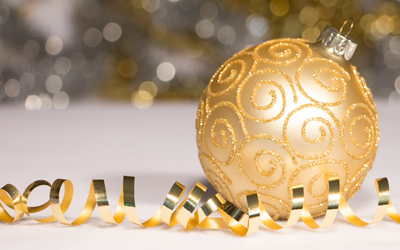 Golden bauble and ribbon wallpaper