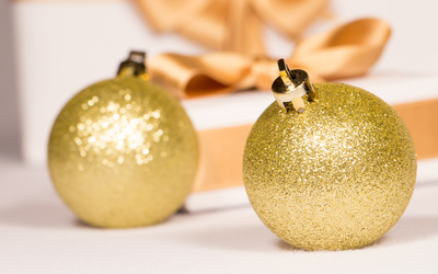 Golden baubles and present wallpaper