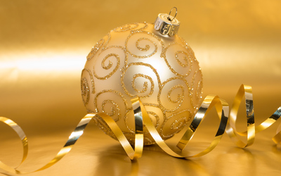 Golden baubles and ribbon wallpaper