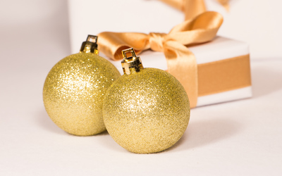 Golden baubles by the Christmas present wallpaper