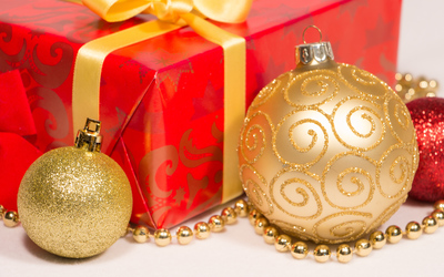 Golden baubles by the present wallpaper