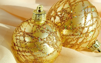 Golden baubles on a scarf wallpaper