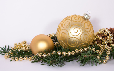 Golden ornaments and cone on a fir branch wallpaper