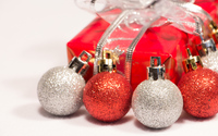 Red and silver baubles with a Christmas present wallpaper 3840x2160 jpg
