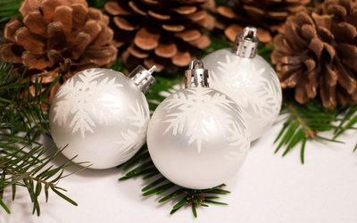 Silver baubles and cones wallpaper
