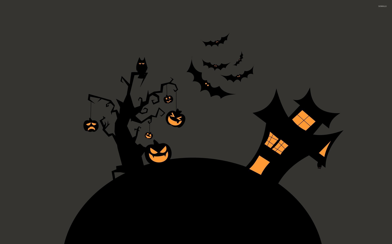 Spooky Pumpkin Tree Near A Haunted House Wallpaper