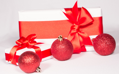 Three red baubles by the presents wallpaper