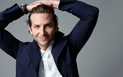 Bradley Cooper with both hands on his head wallpaper
