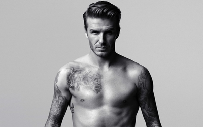 David Beckham showing his tattoos wallpaper