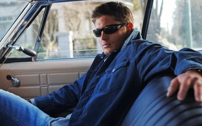 Jensen Ackles in a car wallpaper