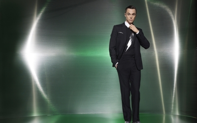 Jim Parsons in a black suit and a hand in his pocket wallpaper