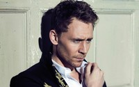 Tom Hiddleston in front of a wooden door wallpaper 1920x1200 jpg