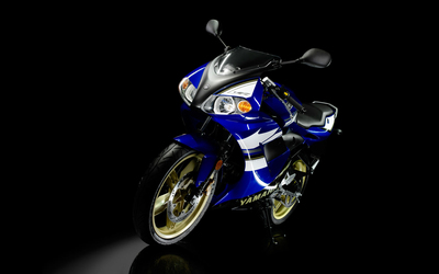 Front view of a blue Yamaha TZR 50 wallpaper