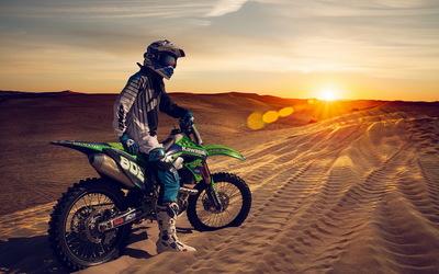 Kawasaki dirt bike in the desert wallpaper