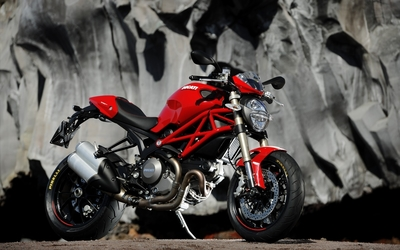 Red Ducati Monster 1100 Evo side view wallpaper