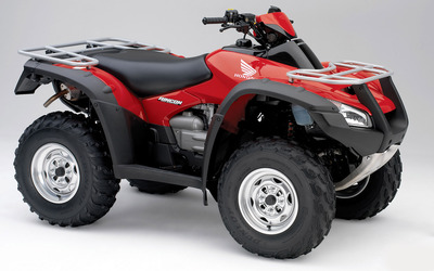 Red Honda TRX680 front side view Wallpaper