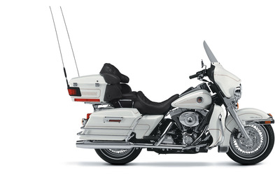 Side view of a white Harley-Davidson Electra Glide wallpaper
