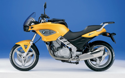 Side view of a yellow BMW F650CS wallpaper