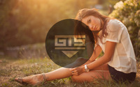 Get The Sound with a girl in the grass wallpaper 2560x1440 jpg