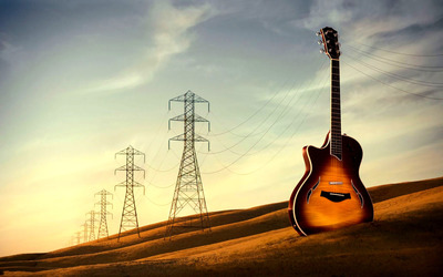 Guitar on the field wallpaper
