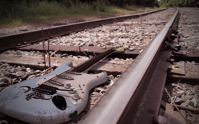 Guitar on the railroad wallpaper