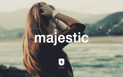 Majestic Casual logo with a hot brunette wallpaper