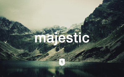 Majestic Casual logo on a mountain lake wallpaper