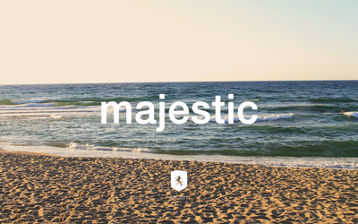 Majestic Casual logo on the beach wallpaper
