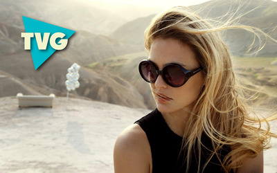 The Vibe Guide with a blonde with sunglasses wallpaper