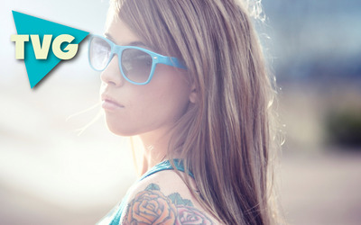The Vibe Guide on a girl with blue sunglasses wallpaper