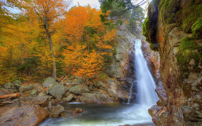 Amazing autumn shades by the rocky waterfall Wallpaper