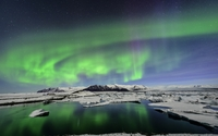 Amazing green aurora above the snowy peaks wallpaper 1920x1200 jpg
